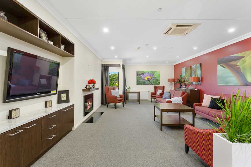 Doutta Galla Footscray - sitting room with television and couches
