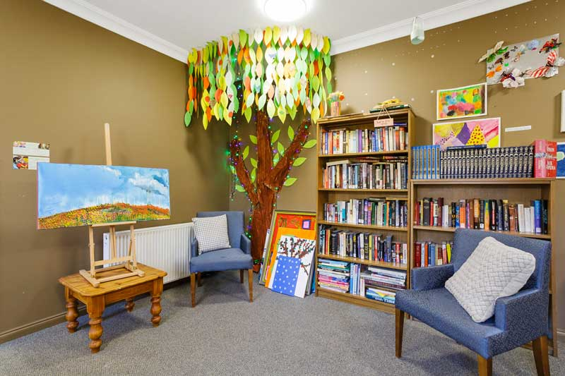 Doutta Galla Footscray - library with large tree and painting