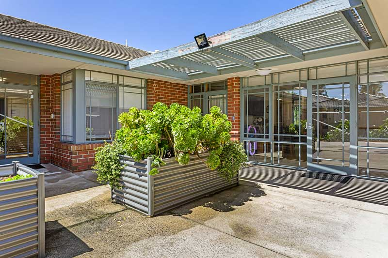 Doutta Galla Grantham Green - outside area with planter boxes