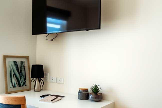 Doutta Galla Harmony Village aged care - desk and television in room