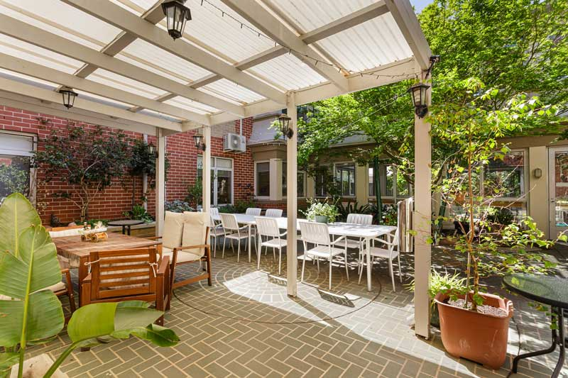 Doutta Galla Queens Park aged care - undercover outside area with couches and table and chairs