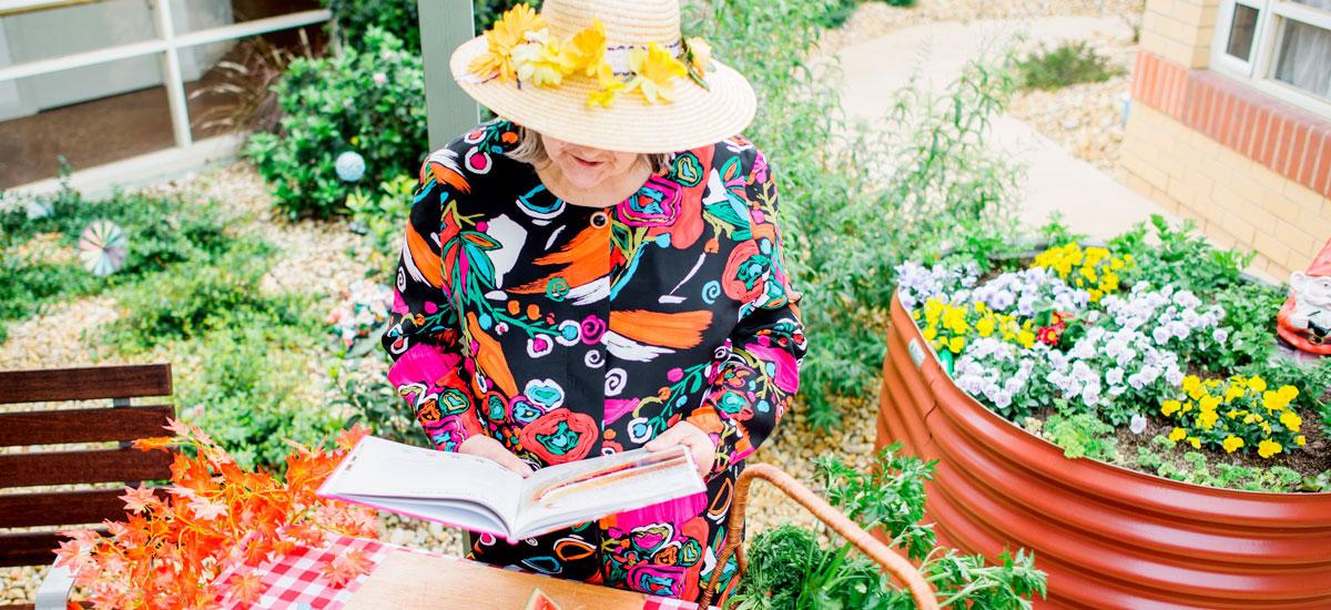 Doutta Galla Lynch's Bridge - senior lady sitting in garden reading