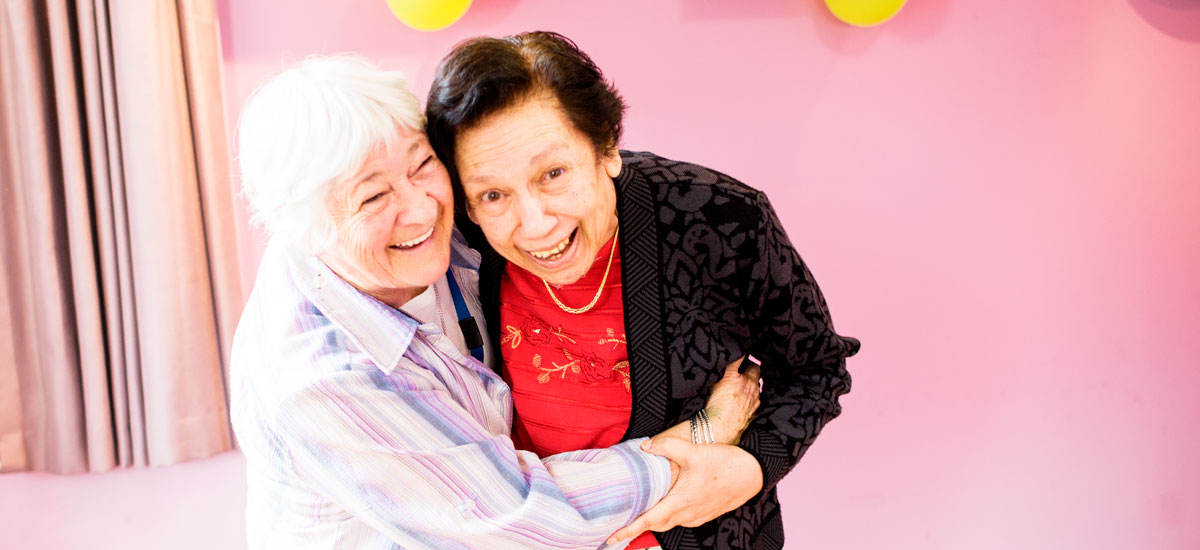 Doutta Galla Queens Park aged care - two senior ladies smiling and embracing