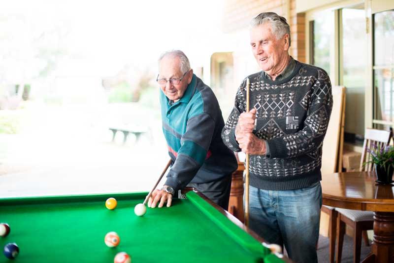 Doutta Galla Harmony Village retirement - senior men playing pool