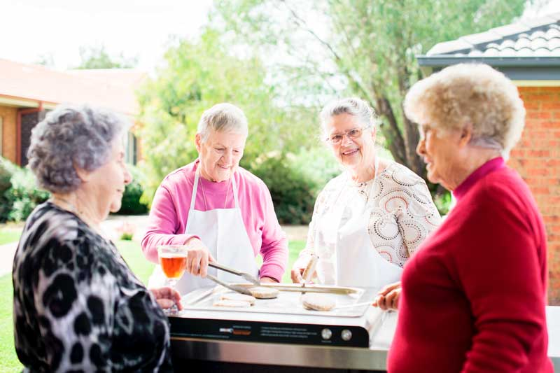 Doutta Galla Harmony Village retirement - senior ladies cooking on the barbecue