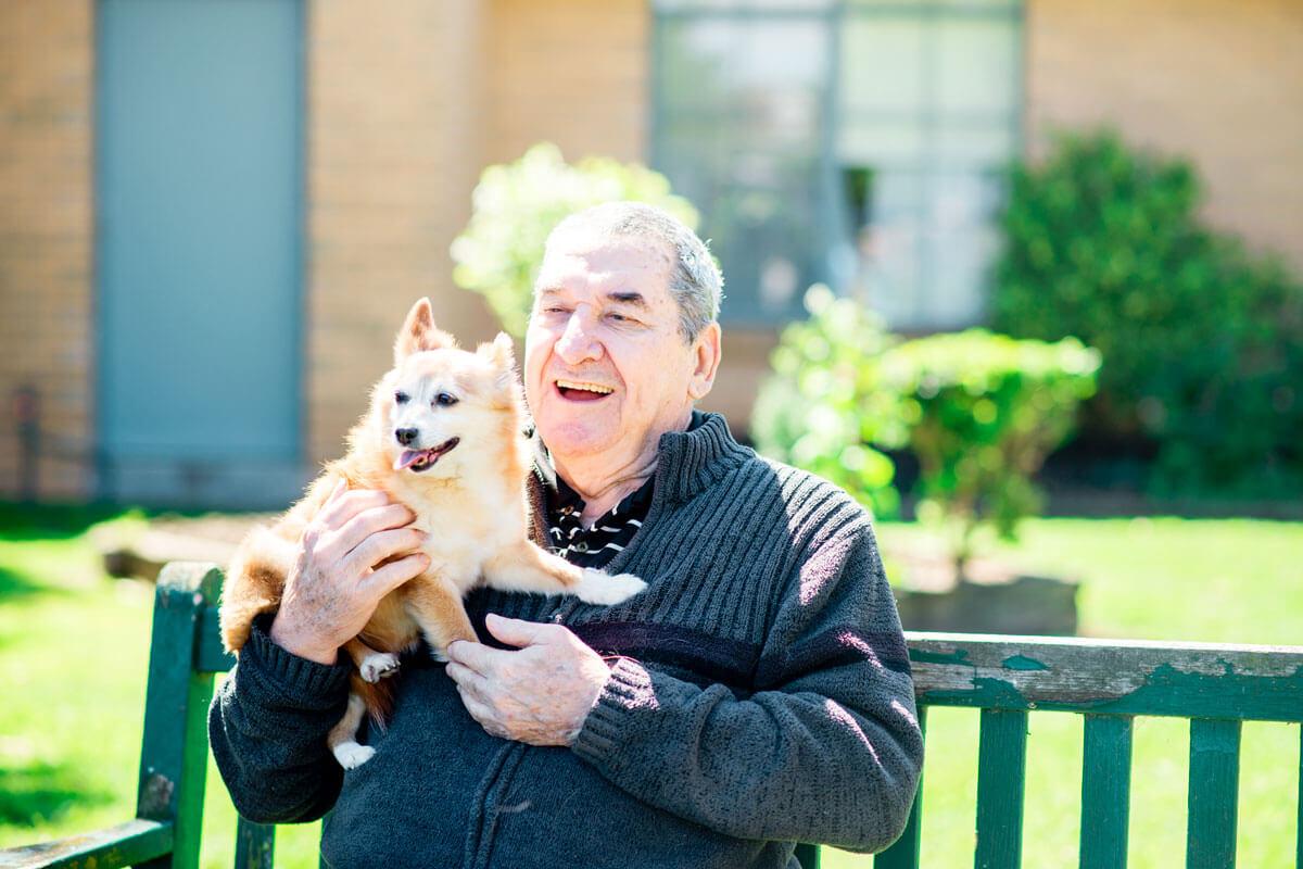 Doutta Galla man with small dog