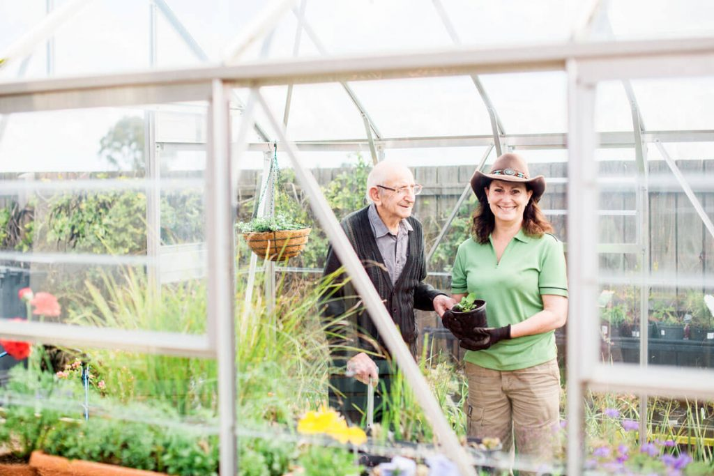Doutta Galla - carer helping resident in greenhouse