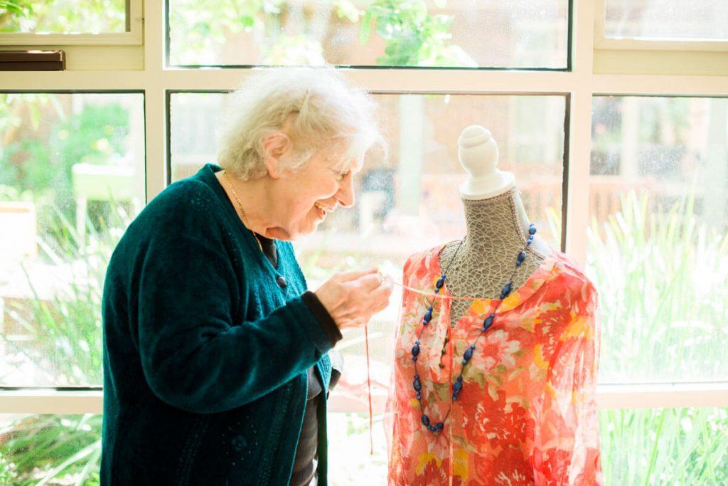 Doutta Galla - lady making dress