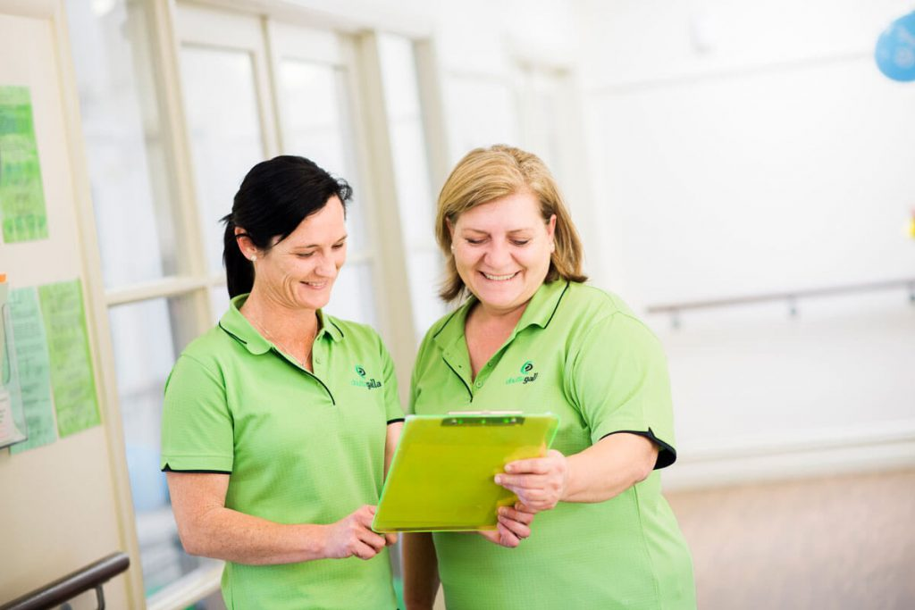 Doutta Galla - two carers looking at schedule